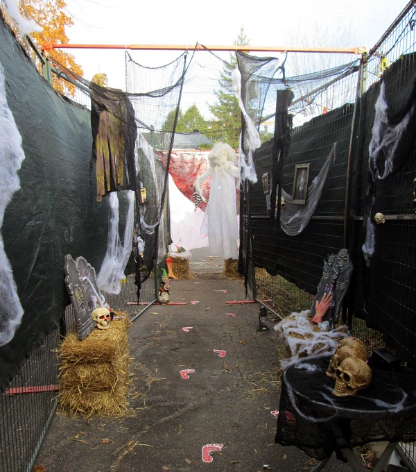 Modu-Loc fence and privacy screen is used with Halloween props to create a haunted house