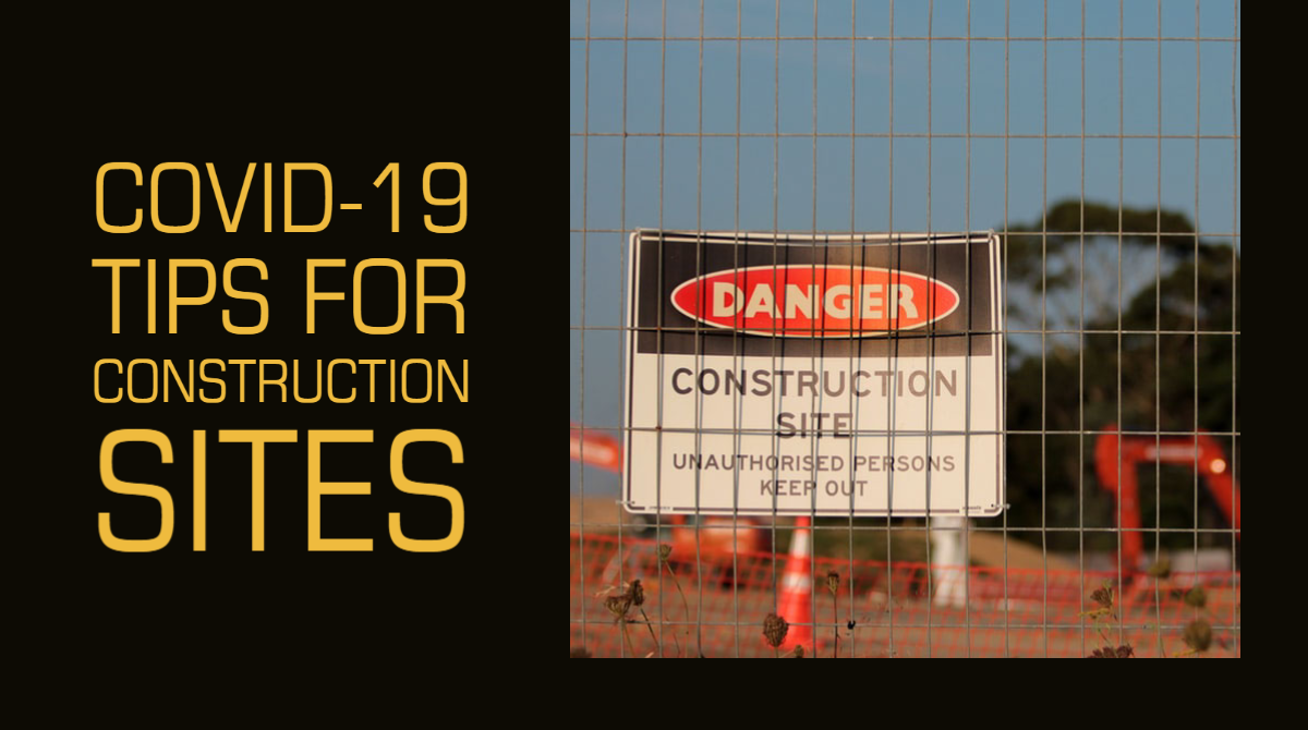 "A construction site can be seen through the wire mesh of a metal fence, from which a sign hangs that reads ""DANGER. Construction Site. Unauthorised persons keep out."""